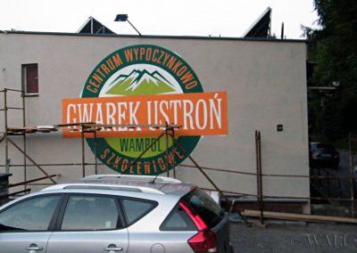 wykonane malowidło - logo na ścianie