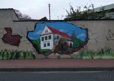 wykonany mural - dziura w murze - Wieluń