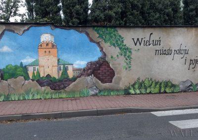 namalowany mural - dziura w murze - Wieluń miasto pokoju