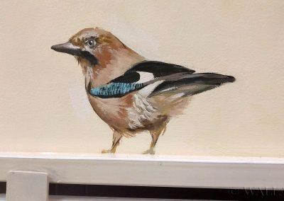 namalowany ptak na ścianie