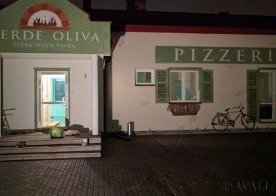 pomalowana elewacja - szyld - pizzeria Oliva Verde Warszawa