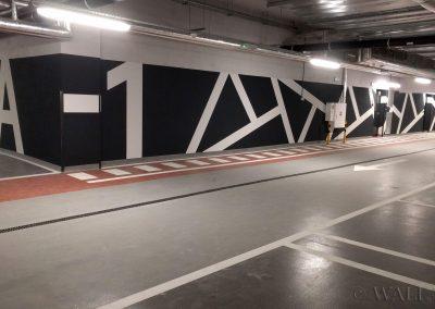 pomalowane ściany - system identyfikacji wizualnej na parkingu